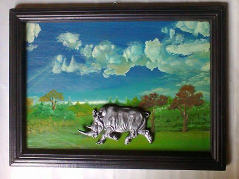 Rhino sculpture on painted background wall hanging 1